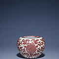 A copper red and underglaze blue-decorated apple-shaped waterpot, Kangxi six-character mark in underglaze blue and of the period (1662-1722)