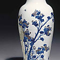 A copper-red and celadon-decorated blue and white carved <b>baluster</b> <b>vase</b>, Kangxi six-character mark and of the period (1662-1722)