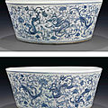 An unusual large blue and white 'dragon and <b>phoenix</b>'jardinière, 18th century