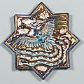 A Kashan star-shaped lustre pottery tile with <b>phoenix</b>, Persia, 13th century