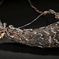 A <b>Tibeto</b>-<b>Chinese</b> carved rhinoceros horn priming-flask. 19th century