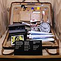 James Bond's suitcase created by Q containing (among others) a Polaroid laser camera and an explosive pack of cigarettes. «Licence to Kill» 1989. Photo: Olivier Daaram Jollant © 2016