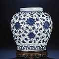 A fine late Ming blue and white 'lotus' jar, Wanli six-character mark within double-circles and of the period (1573-1619)