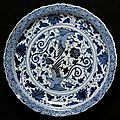 Dish, porcelain painted in underglaze blue with phoenixes <b>and</b> <b>flowers</b>, China, Yuan dynasty, mid 14th century