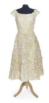 A white silk guipure evening gown. Cristobal Balenciaga, 1960s.