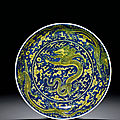 An underglaze-blue and yellow-enamelled 'dragon' dish, kangxi six-character mark within double circles and of the period