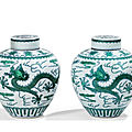 Two <b>green</b>-<b>enamelled</b> 'dragon' jars and covers, Qianlong seal marks and period (1736-1795)