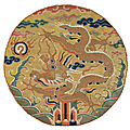 An imperial Ming dynasty embroidered five-clawed 'dragon' roundel, late Ming dynasty, <b>16th</b>-<b>17th</b> <b>century</b>