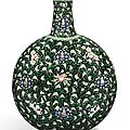 A fine and rare <b>famille</b>-<b>noire</b> 'floral scroll' moonflask, Qing dynasty, Yongzheng period