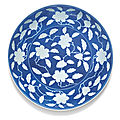 A rare reverse-decorated powder-<b>blue</b> '<b>Gardenia</b>' dish, Yongzheng mark and period (1723-1735)