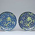 A pair of <b>blue</b>-<b>ground</b> <b>yellow</b>-<b>enamelled</b> 'Dragon' dishes, Daoguang six-character seal marks in underglaze <b>blue</b> and of the period