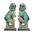 A pair of famille verte <b>biscuit</b>-<b>glazed</b> Buddhist lions, Kangxi peiod (1662-1722)
