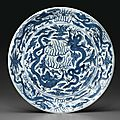 A large blue and white 'dragon' dish, Wanli six-character mark in underglaze blue within a double-circle and of the period (1573-1619)