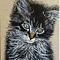 Une toile : un petit chat