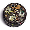 An embellished zitan 'Squirrel and grapevine' circular <b>box</b> and cover, Qing dynasty, Qianlong period (1736-1795)