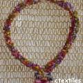 collier tricoté ras du cou