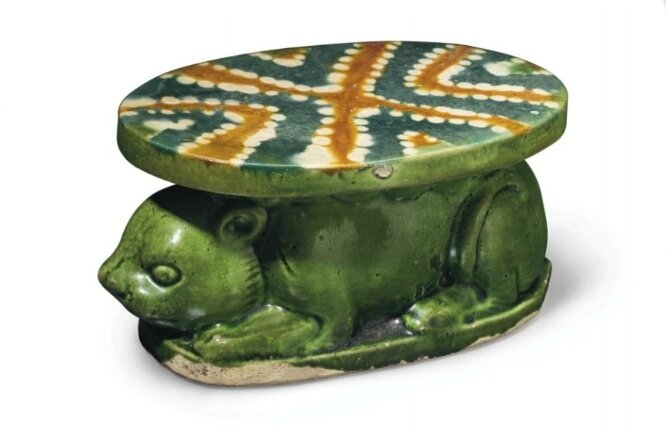 A blue and sancai-glazed pottery pillow or wrist rest, China, Tang dynasty (AD 618-907)