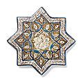 A <b>Kashan</b> lustre pottery star tile, Persia, 13th-14th Century