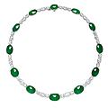 An <b>oval</b> <b>jadeite</b> <b>cabochon</b> and diamond necklace