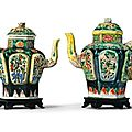 A pair of 'famille noire' biscuit ewers and covers. qing dynasty, kangxi period