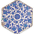 An Iznik hexagonal blue and turquoise pottery tile, Turkey, first-half <b>16th</b> <b>century</b>