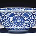 A <b>blue</b> <b>and</b> <b>white</b> '<b>lotus</b>' <b>bowl</b>, Kangxi six-character mark in underglaze <b>blue</b> within a double circle <b>and</b> of the period (1662-1722)