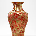 A <b>coral</b>-<b>ground</b> <b>gilt</b>-<b>decorated</b> 'bats and lotus' quatrefoil vase, Jiaqing six-character seal mark in iron-red and of the period