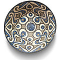 A Kashan blue and <b>black</b> <b>pottery</b> bowl with palmettes, Persia, early 13th century