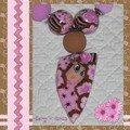 page détail collier rose-brun visage pendentif pointu 2
