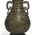 A rare <b>and</b> finely cast imperial bronze 'dragon' vase, <b>Qianlong</b> <b>mark</b> <b>and</b> <b>period</b> (<b>1736</b>-<b>1795</b>)