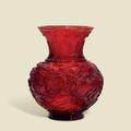 A ruby-red glass baluster vase, Qianlong incised four-character mark within a square and of the period (1736-1795)