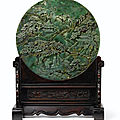 An imperial <b>spinach</b>-<b>green</b> <b>jade</b> double-carved screen, Qing dynasty, Qianlong period (1736-1795)