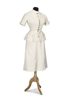 A cream matelassé summer suit. Cristobal Balenciaga, c. 1950. Im