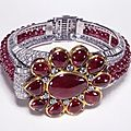 Cartier. Bangle, <b>1937</b>, diamonds and a double row of rubies set in platinum with a 19th century Indian central motif