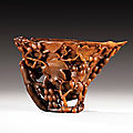 A carved rhinoceros horn libation cup, China, Qing dynasty, 18th century.